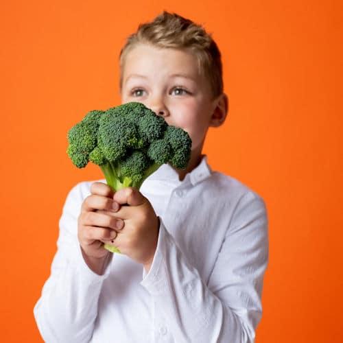 child with broccoli